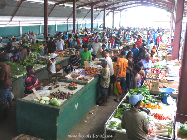 Chaguanas Market in Trinidad shot from above showing many vendors with produce and shoppers.