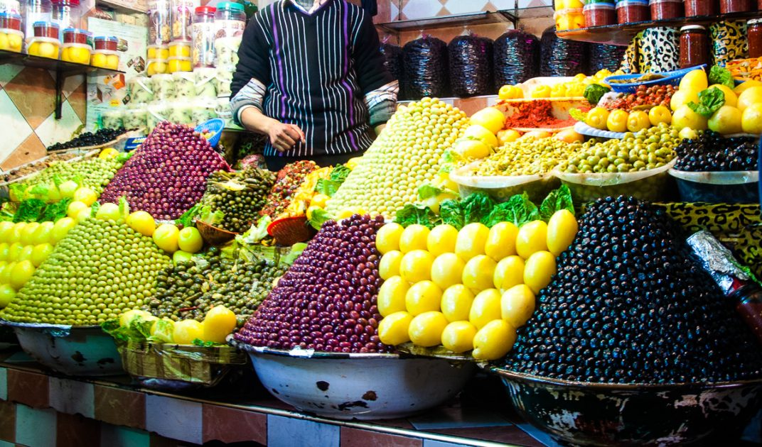 Piles of fresh fruit and olives at a stall in the medina in Meknes.