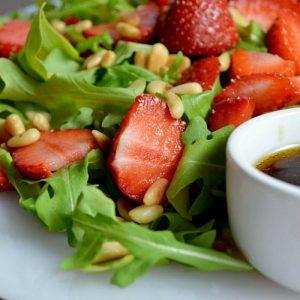A close up of a Strawberry Arugula Salad