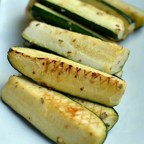 A close up of grilled zucchini sticks