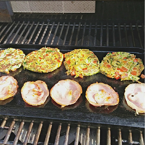 Zucchini burgers and pancetta on a grill pan on the barbeque