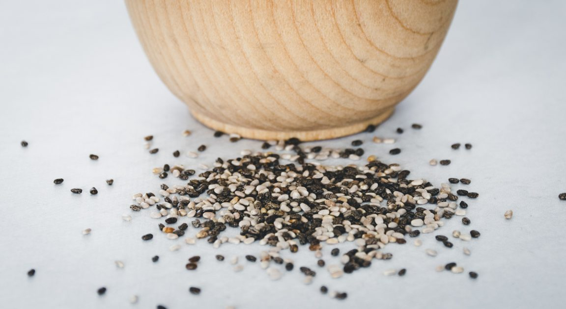 Up close shot of black, brown and white chia seeds.